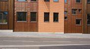 Современные фасады Тарту: кирпич, медь, дерево, патина